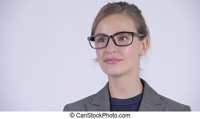 Face of young happy businesswoman with eyeglasses thinking -...