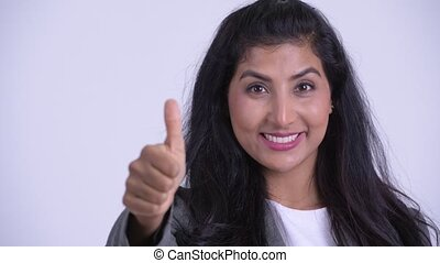 Face of young happy Persian businesswoman giving thumbs up -...