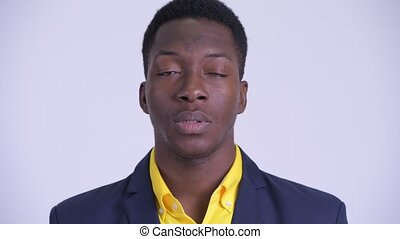 Face of young serious African businessman nodding head no -...