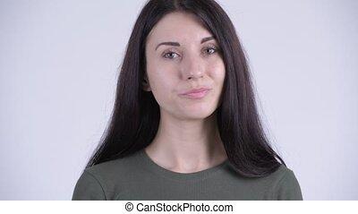 Face of young serious woman nodding head no - Studio shot of...