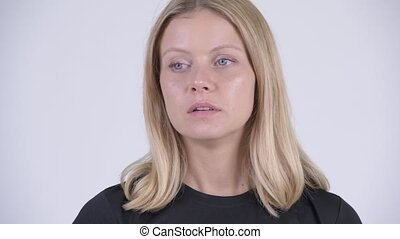 Face of young stressed blonde woman looking bored and tired...
