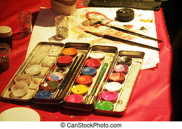 face paint and brush