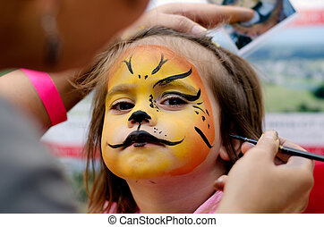 Face painting - Cute little girl with face painted like a ...