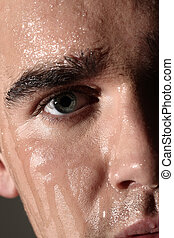 Face portrait of wet and handsome man