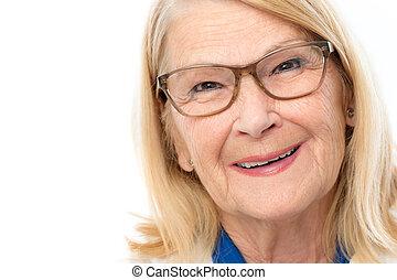 Face shot of attractive senior woman.