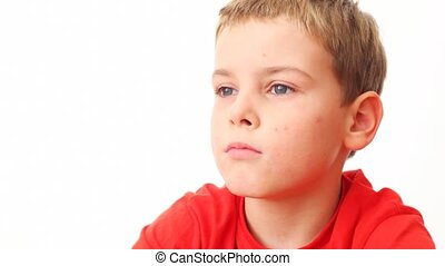 face small boy in red t-shirt close up on white background