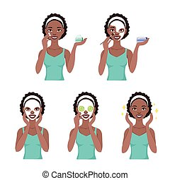 Attractive pretty young black woman dressed in casual t-shirt care her face and skin, using cream and applying natural mask. Facial treatment procedures, african american, healthy lifestyle.