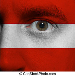 Face with the Austrian flag painted on it