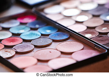 Faced multicolor cosmetics.