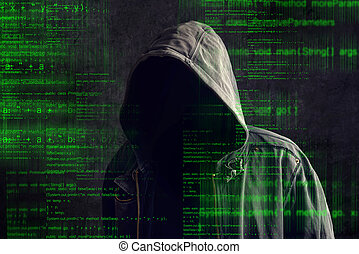 Faceless hooded anonymous computer hacker with programming...