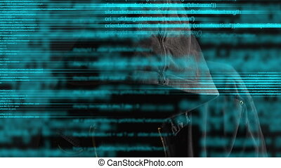 Faceless hooded computer hacker