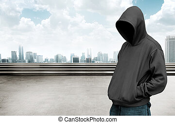Faceless man in hood