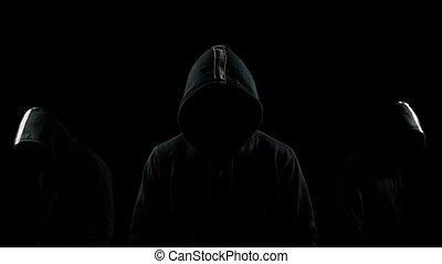 Faceless men in the dark