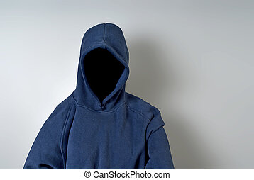 A blue hoodie with nothing but a dark shadow in place of a face against a white wall with copy-space.