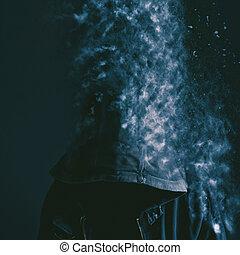 Faceless unrecognizable man vanishing into dust