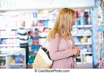Faceless Woman in Grocery Store