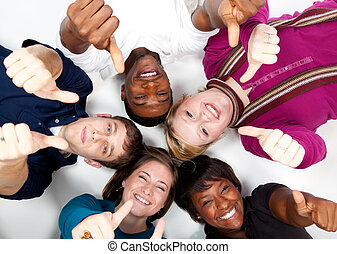 faces of smiling multi-racial college students with their thumbs up