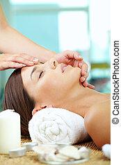 Facial at spa salon - Portrait of a woman enjoying facial