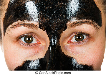 Facial black mask - Young woman with facial black mask on ...