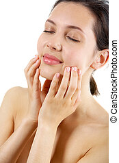 Portrait of calm female with her hands on face taking pleasure