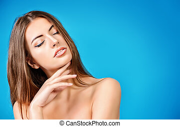 facial cream - Portrait of a beautiful tender young woman...