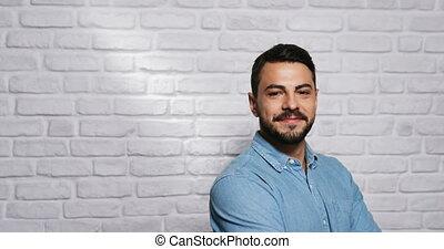 Facial Expressions Of Young Beard Man On Brick Wall -...