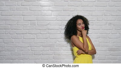 Facial Expressions Of Young Black Woman On Brick Wall -...
