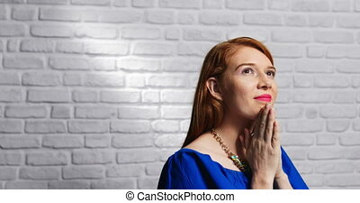 Facial Expressions Of Young Redhead Woman On Brick Wall -...