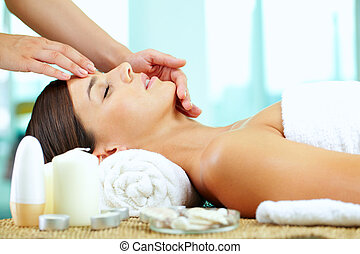 Facial - Female hands massaging young woman?s face