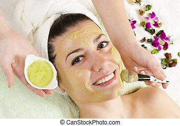 Facial Green Mask - Attractive young woman getting a facial...