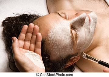 Facial - man relaxing with a nice facial lotion