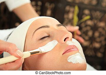 Facial Mask - Young woman receiving mask - SPA