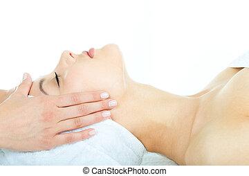 Facial massage - Beautiful woman is getting a facial massage...