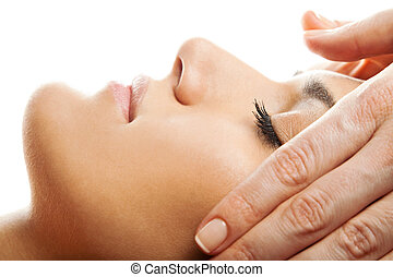Facial massage isolated - profile close-up of a beautiful...