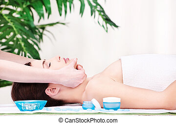 facial massage - Lady in spa salon having a facial massage