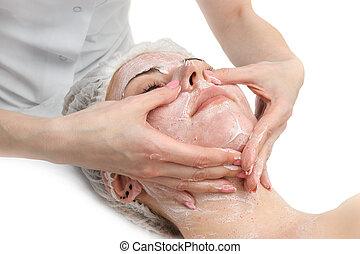 facial massage with scrub mask