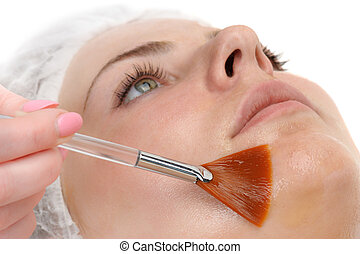 facial peeling mask applying - beauty salon, facial peeling...