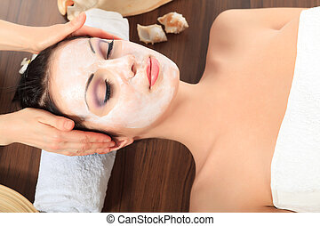 facial - Portrait of a woman with spa mask on her face. ...