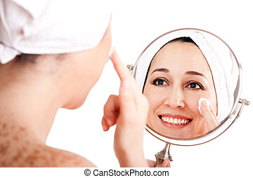Facial skincare anti-ageing exfoliation - Beautiful happy...