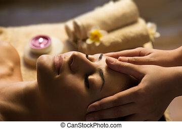 Facial SPA massage - Beautiful woman getting spa treatment. ...