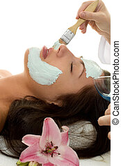 Facial Treatment - A beautician applying a facial treatment ...