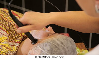 Facial treatment and lifting therapy massage from a doctor