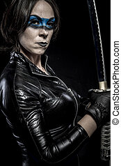 Facial, Woman with katana sword in latex costume