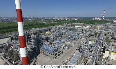 Flying over the area of oil refinery. Aerial view of industrial area with petroleum processing facilities