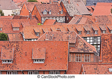 Facing at the red roofs of the medieval city Quedlinburg in ...