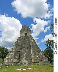 Facing to the main building of old maya ruins in the jungle - Tikal - Guatemala.