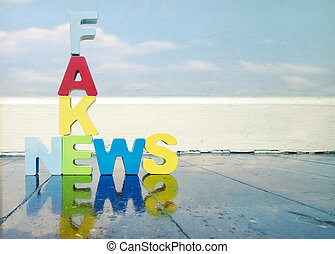 Fack News ,wooden letters on old wooden floor with...