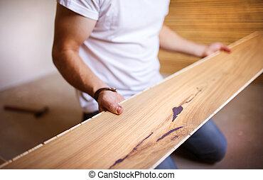 factótum, instalación, piso de madera