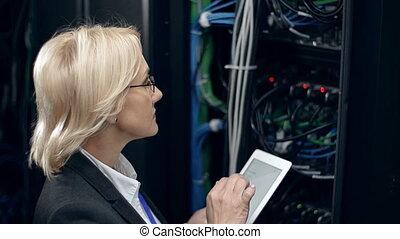 Factor Analysis - Female scientific worker checking...