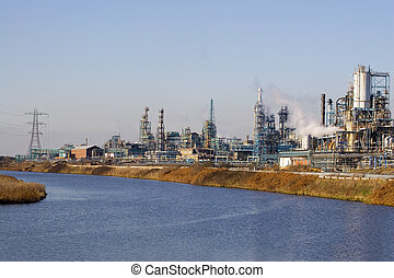 Factory 9 - A view of a chemical factory by a river